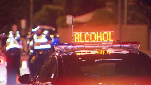 Adelaide news: Driver on run after ramming police car almost hitting