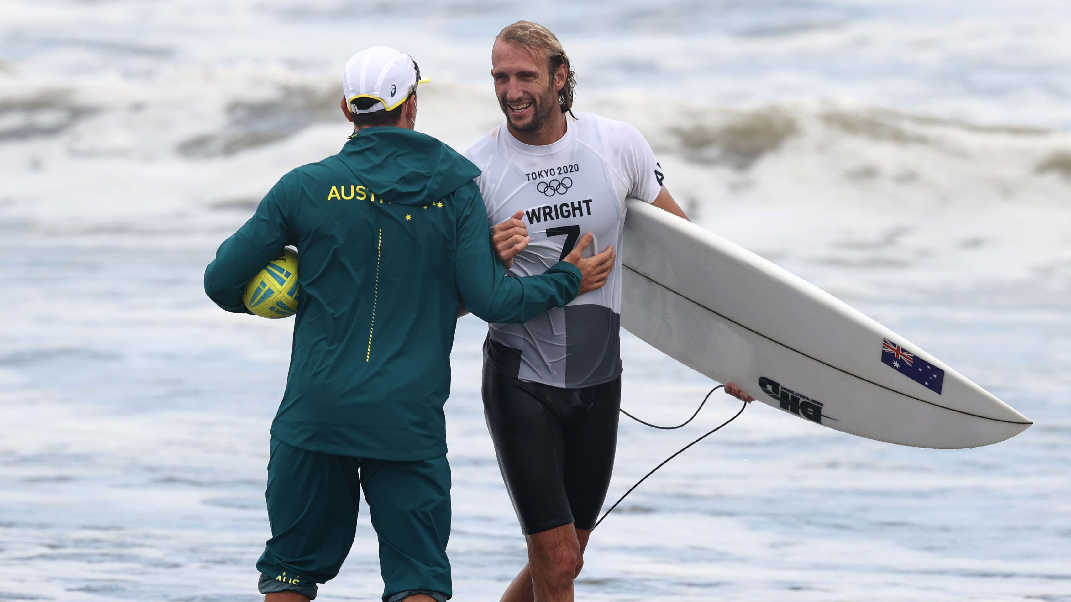 Owen Wright celebrates a victory in the Olympics surfing competition.