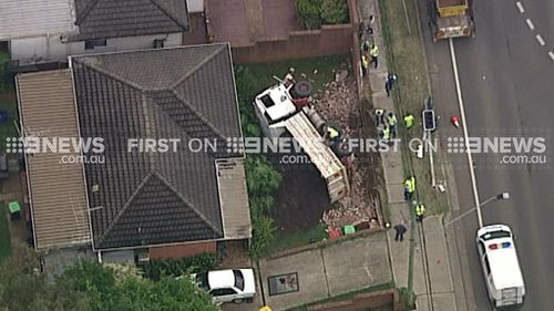 Truck overturns in front of house in Sydney's west