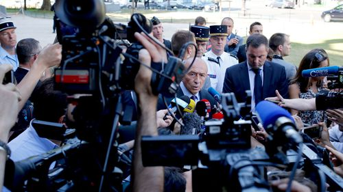 French Interior Minister Gerard Collomb speaks to reporters after a driver rammed a car carrying explosives into a police convoy on the Champs-Elysees avenue, in Paris. (AAP)