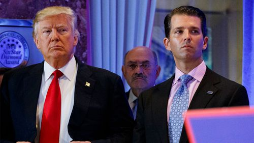 Donald Trump, left, his chief financial officer Allen Weisselberg, centre, and his son Donald Trump Jr.