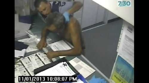 Video footage shows 62-year-old Phil Dickson slapped by an officers in Geelong police station.