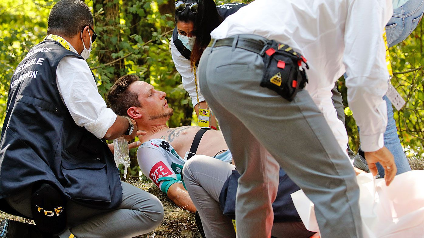 Lukas Postlberger of Austria is treated by medics during the stage 19