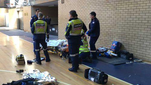 Man falls 10m through roof at Sydney school