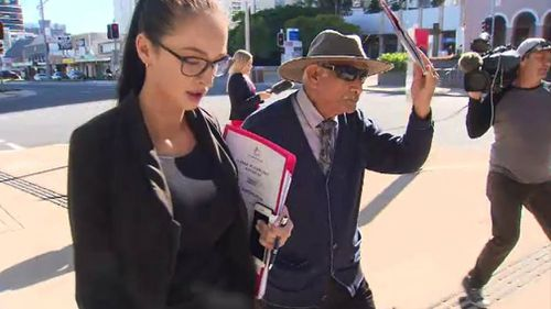Sami Gindi leaves court with his lawyer. Picture: 9NEWS