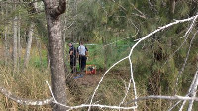 """""""We're looking for Sharron's remains – the information is specific that she has been buried out here,"""" Homicide Group Acting Detective Superintendent Damien Hansen said at the excavation site, on council-owned bushland off Cobalt Street."""