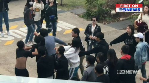The brawl broke out between fans of Chinese band Nine Percent and a media crew.