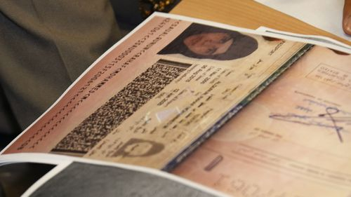 A passport copy of Rahaf Mohammed Alqunun sits on the desk.