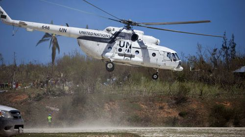 UN aid arrives by helicopter in southwest Haiti, after Hurricane Matthew left over 800 dead and thousands without homes. (AP)