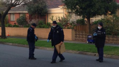 Forensic police start to bag evidence at Noble Park where a man's body has been found. (9NEWS)