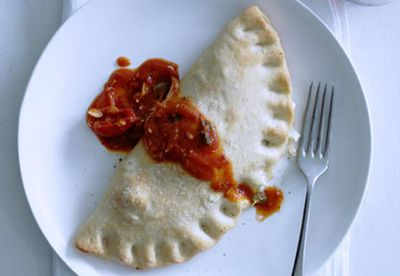 "Recipe:&nbsp;<a href=""/recipes/itomato/8298279/three-cheese-calzone-with-tomato-chilli-sugo"" target=""_blank"" draggable=""false"">Three-cheese calzone with tomato-chilli sugo</a>"