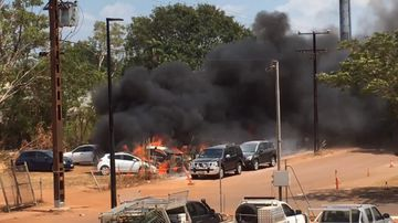 Vehicles destroyed as fire tears through carpark