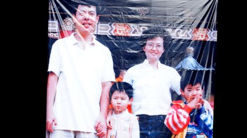 A portrait of the Lin family  displayed at their 2009 funeral. (AAP)