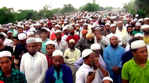 Thousands of Bangladeshi Muslims gather to attend the funeral of a popular Islamic preacher on Saturday, April 18, 2020.