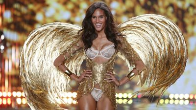 French model Cindy Bruna flashes a cheeky smile at the Victoria's Secret Fashion Show in London. (AAP)