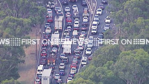Traffic on the Hume Highway at Lansvale is at a standstill due to the nearby factory fire. (9NEWS)