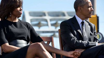 Michelle and Barack Obama hold hands at the Selma anniversary commemoration in 2015.