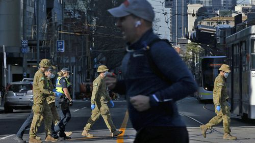 Members of the ADF (Australian Defence Force) patrol with Members of Victoria Police on August 02, 2020 in Melbourne.