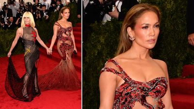 Singer and actress Jennifer Lopez arrived in a gown custom made by Donatella Versace, with Donatella herself. (AAP)