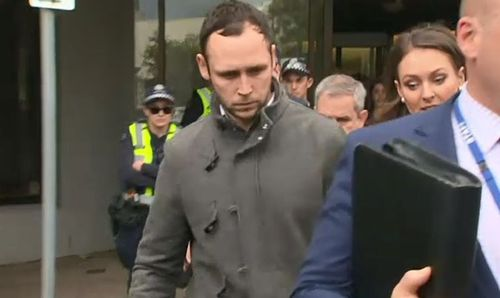 Mr Wells was escorted out of court with a huge police presence after being again released on bail. Picture: 9NEWS