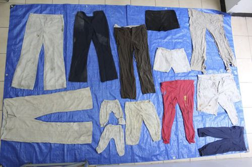 Some of the small pairs of trousers find in the burial pit in the state of Veracruz in the Gulf of Mexico.