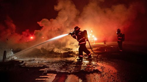 Firefighters battle California blazes.