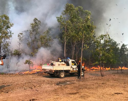 Three bushfires near Darwin have been reduced to Advice level after earlier threatening homes