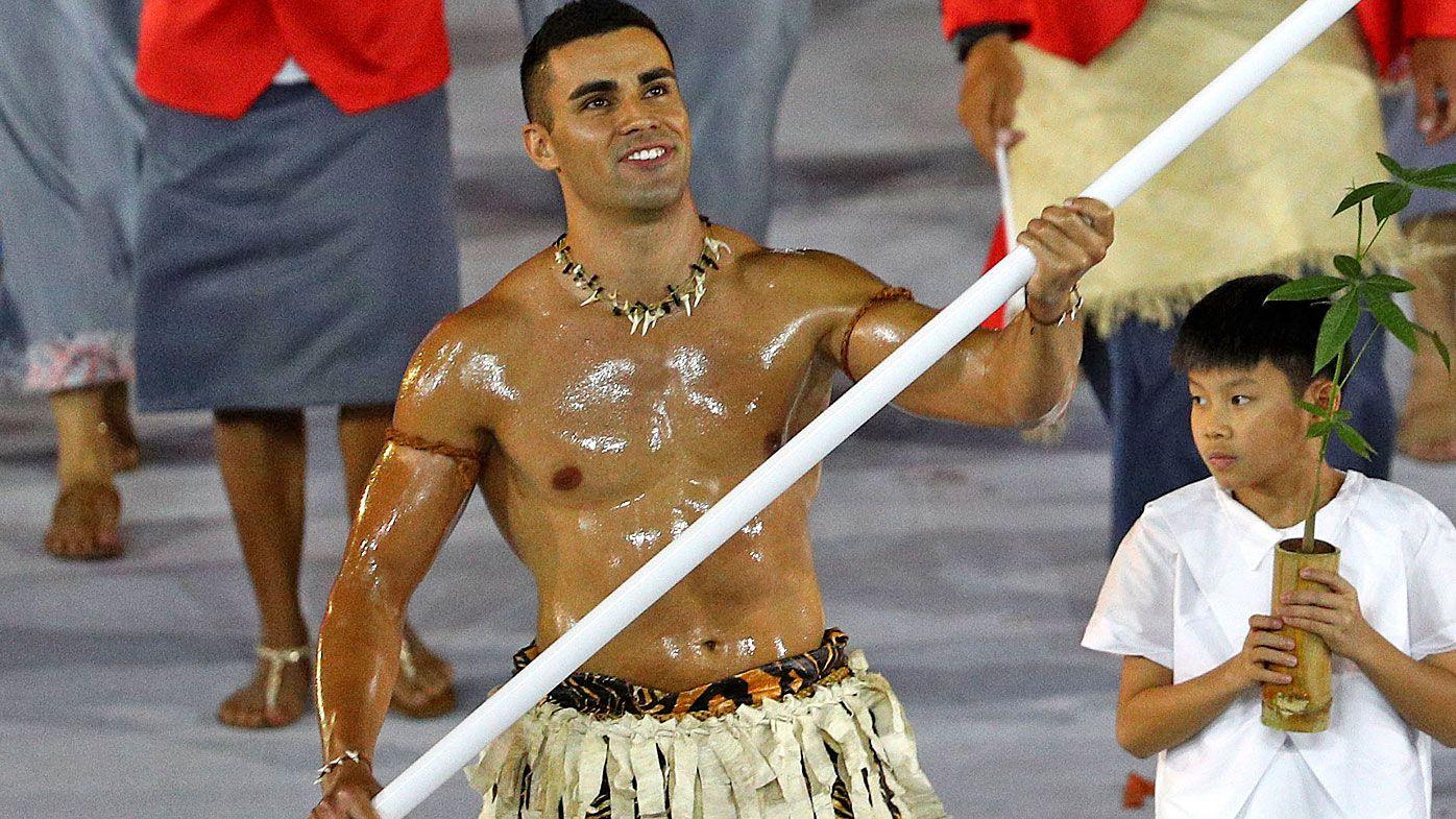 Flag bearer Pita Nikolas Aufatofua of Tonga leads his Olympic Team