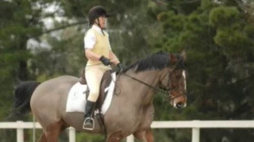 Ms Trease, a vet, is also a keen horse rider. (9NEWS)