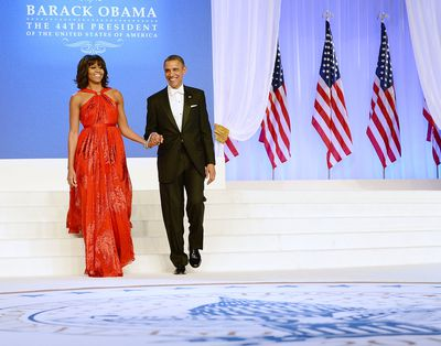 <p>At her husband's second Inaugural Ball in Washington, D.C., in January 2013 in a bold red, flowing gown by Jason Wu. The gown's fitted waist and metal detail wowed.</p> <p>Image: Getty.</p>