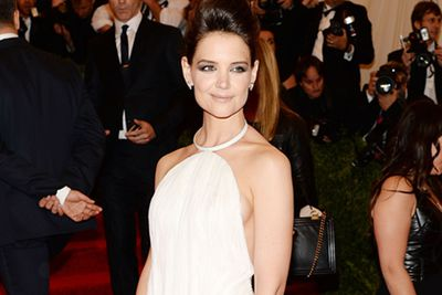 I spy with my little eye… a glimpse of round perky flesh peeking out of Katie Holmes' backless white gown.