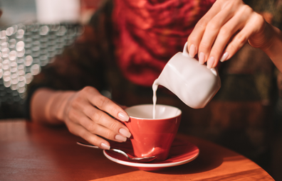 Pouring milk into a cup of tea