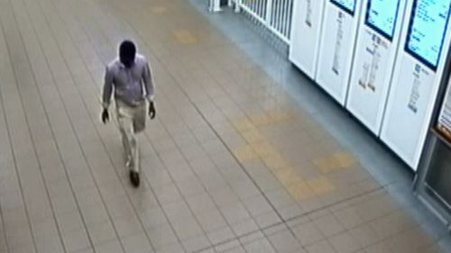 CCTV shows the man boarding the train at Wynyard Station on New Year's Day. (NSW Police)