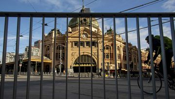 A cyclist passes an empty Flinders Street Station during lockdown due to the continuing spread of the coronavirus in Melbourne.