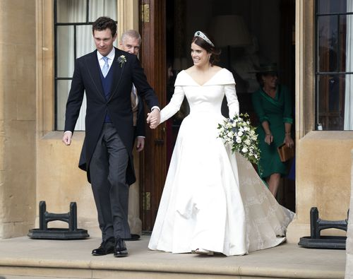Mr and Mrs Jack Brooksbank leave Windsor Castle to attend a second reception after their weddding.