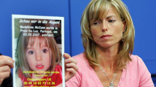 Kate McCann, the mother of the missing British girl Madeleine McCann, looks at a poster showing her missing daughter during a press conference on June 6, 2007 in Berlin.