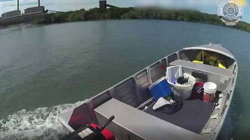 The police officer commandeered another boat at a nearby ramp to chase down the loose tinny.
