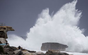 Eastern states in grip of cold snap while WA braces for rare cyclone