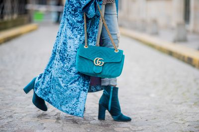 "<p><strong>Classic inspiration:</strong> Gitta Banko carrying a petrol-coloured velvet Marmont GG Gucci bag seen during Paris Fashion Week Spring/Summer 2018 on October 2, 2017.</p> <p><strong>Buy in red:</strong> Gucci Marmont velvet bag in red velvet approx. $3001.41 at <a href=""https://www.vestiairecollective.com/women-bags/handbags/gucci/red-velvet-marmont-gucci-handbag-4930389.shtml"" target=""_blank"" draggable=""false"">Vestiaire Collective<br /> </a></p>"