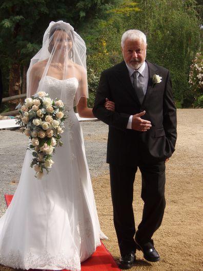 Chris walking his daughter down the isle