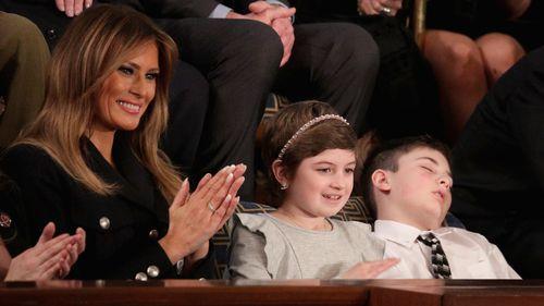 Melania Trump with Grace Eline and Joshua Trump