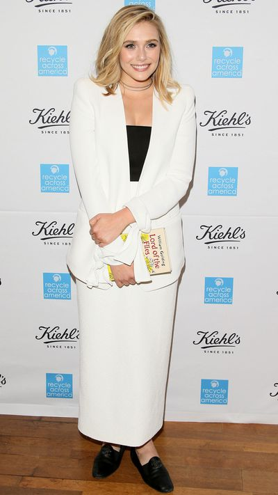 Here she is in a Rosetta Getty dress, Chloé blazer and the thinking-girl's accessory of choice: an Olympia Le-Tan <i>Lord Of The Flies</i> book clutch.