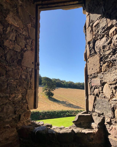 The view from Balvenie Castle to the woods. Please note; not a cloud to be seen.