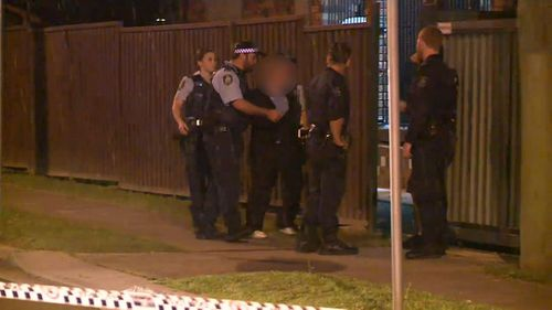 Police spoke to a man outside the home where Yilmaz was murdered. (9NEWS)