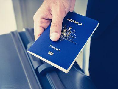 Man holding Australian passport