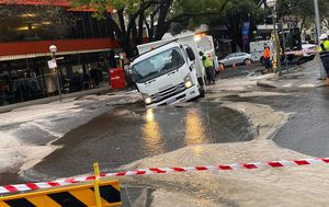 Sydney sinkhole swallows truck as rain continues