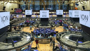 In this photo provided by the New York Stock Exchange, traders work on the floor during the listing of ION Acquisition Corp 1 Ltd., from Israel, Friday, October 2, 2020