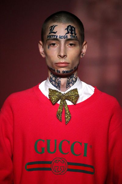 "<p>The star of Gucci's spring/summer '17 campaign boasts more than sculpted cheekbones and piercing eyes.</p> <p>Latvian model Lorens caused a stir on the runway at the Gucci show at <a href=""https://style.nine.com.au/2015/09/24/09/32/gucci-ss16-runway"" target=""_blank"">Milan Fashion Week</a>&nbsp;in September with William Blake quotations tattooed across his face.</p> <p>The bold look earned the shy 18-year-old pride of place in the Italian label's latest campaign photographed by Glen Luchford. The shoot takes place in creative director Alessandro Michele's home town of Rome.</p> <p>Away from the Gucci fairy dust Lorens is slightly less intimidating, with the tattoos washing off to reveal a face any mother could love.</p> <p>The campaign, which also features tigers, lions and the Trevi Fountain will debut on January 1.</p> <p>See the Gucci campaign images here, along with other, more permanent, fashion ink.</p> <p>&nbsp;</p>"