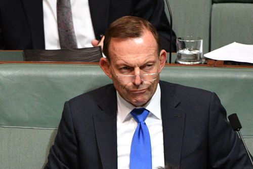 Former prime minister Tony Abbott has refused to rule out crossing the floor of parliament and voting against Malcolm Turnbull's signature energy policy. Picture: AAP.