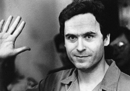 Ted Bundy mugs for the media after being informed of his indictment by a grand jury in Tallahassee, Florida.